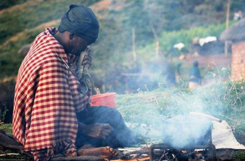 A mosotho woman cooking. Image Credit: Technologies for Economic Development (TED)